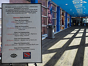"""13 MARCH 2020 - DES MOINES, IOWA: A sign at the entrance to Wells Fargo Arena, which is hosting the state boys high school basketball tournament. Tournament organizers announced that no spectators would be allowed at games starting Friday. The Governor of Iowa announced Friday that 17 people in Iowa have tested positive for the Novel Coronavirus. Of those, 15 people were exposed on the same cruise in Egypt, the others were exposed through travel but were not on the same cruise. The Governor said there has not yet been any """"community spread"""" in Iowa. All of the Iowans who have tested positive are in self quarantine. Across Iowa, municipalities and businesses are taking steps to implement """"social distancing."""" Most of the colleges in Iowa have announced that they will remain closed after their spring breaks and that classes will move to online only, after spring break. Many businesses in Des Moines, including Nationwide Insurance and EMC Insurance, have announced plans to have their employees to telecommute. The mayor of Des Moines has urged event planners to consider canceling large events.     PHOTO BY JACK KURTZ"""