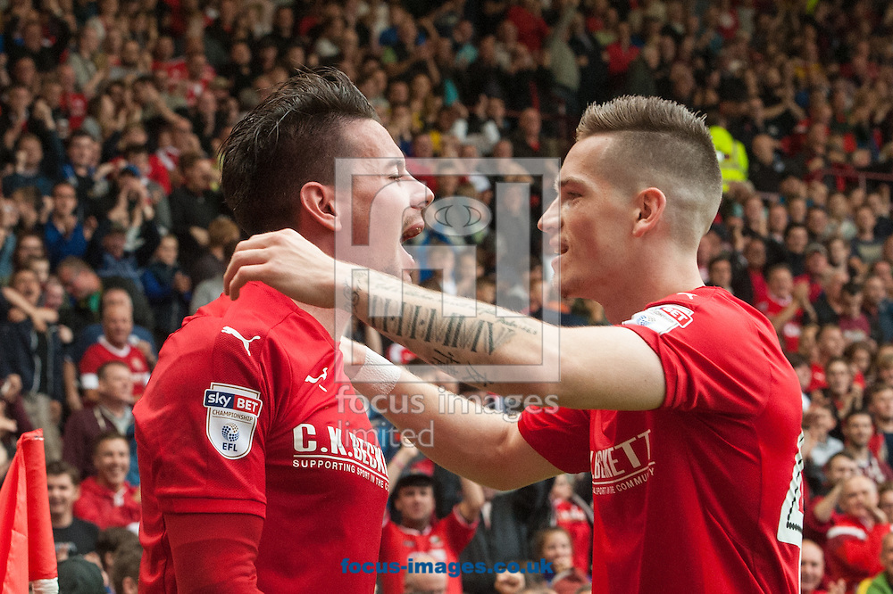Adam Hammill (left) celebrates with Ryan Kent of Barnsley after scoring his sides second goal during the Sky Bet Championship match at Oakwell, Barnsley<br /> Picture by Matt Wilkinson/Focus Images Ltd 07814 960751<br /> 27/08/2016