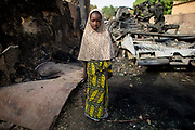 Six year old Malian girl Aissata Coulibaly poses for a photograph in the street in which she lives in Diabaly, Mali 26 January 2013. This photograph is part of a picture package of portraits showing children living along the same street in the small rice growing community of the northern Malian town of Diabaly who in the month of January 2013 lived through a rapid chain of events in the Malian war.