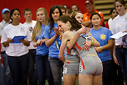 Wartburg Women's 5K runner Laura Sigmund, left, and Alana Enabit, right, embrace after finishing first and second during Saturday's NCAA DIII Indoor Track and Field Championships on Saturday.