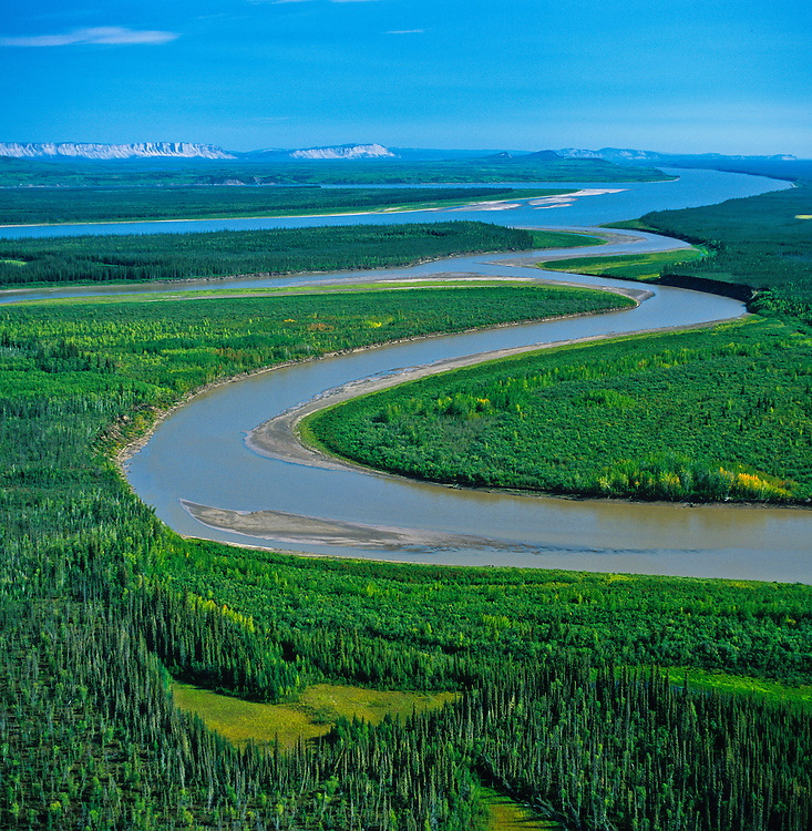 Confluence of Carcajou River and Mackenzie River. Caracajou wetlands in  foreground..Mackenzie Valley,  NWT, August 2005.This region will be directly impacted by the proposed Mackenzie Valley National Gas Pipeline. This pipeline would bring gas from the Beaufort Sea. The primary destination for the natural gas will be to fuel the energy needs of the Alberta Oil Sands mega-project.  Copyright Garth Lenz. Contact: lenz@islandnet.com www.garthlenz.com.Copyright Garth Lenz. Contact: lenz@islandnet.com www.garthlenz.com