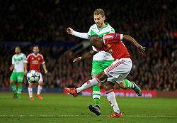 MANCHESTER, ENGLAND - Wednesday, September 30, 2015: Manchester United's Ashley Young in action against VfL Wolfsburg's Nicklas Bendtner during the UEFA Champions League Group B match at Old Trafford. (Pic by David Rawcliffe/Propaganda)