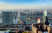 Nederland, Zuid-Holland, Rotterdam, 18-02-2015; skyline en binnenstad van Rotterdam, gezien vanaf de Kop van Zuid en de Wilhelminapier. In het midden Erasmusbrug en Noordereiland, rivier de Nieuwe Maas. Op de Wilhelminakade links De Rotterdam. <br /> Newly developed cultural center Kop van Zuid, urban renewal and modern architecture, high rise in a former harbour area<br /> luchtfoto (toeslag op standard tarieven);<br /> aerial photo (additional fee required);<br /> copyright foto/photo Siebe Swart