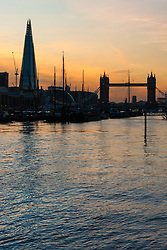 London, March 10th 2015. The sun sets over London after a warm early spring day. PICTURED: The Shard and Tower Bridge, two iconic London Landmarks from different eras bathe in the warm evening light.