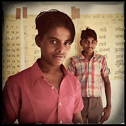 "iPhone portrait of (L-R) Sunil Kumar Katara, 12, and Laalu Ram Ninama, 13, in a village outside of Banswara, Rajasthan, India, April 5, 2013. ""I am a little child now. If I were married and children were born, how would I take care of them if I am also still a child? If we were to get married at this age, neither of us could study or do anything. Life would be ruined. And now if we study and get a job, then we will be able to earn, eat and take care of our kids,"" said Katara. <br />  <br /> Under Indian law, children younger than 18 cannot marry. Yet in a number of India's states, at least half of all girls are married before they turn 18, according to statistics gathered in 2012 by the United Nations Population Fund (UNFPA). However, young girls in the Indian state of Rajasthan—and even a few boys—are getting some help in combatting child marriage. In villages throughout Tonk, Jaipur and Banswara districts, the Center for Unfolding Learning Potential, or CULP, uses its Pehchan Project to reach out to girls, generally between the ages of 9 and 14, who either left school early or never went at all. The education and confidence-building CULP offers have empowered youngsters to refuse forced marriages in favor of continuing their studies, and the nongovernmental organization has provided them with resources and advocates in their fight."