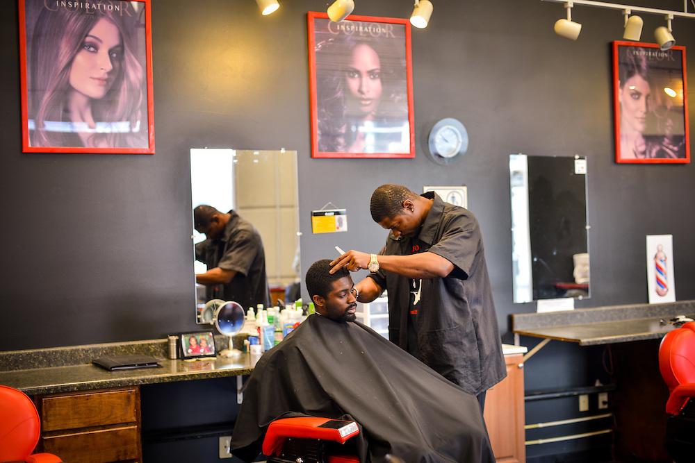 Customer getting a haircut at Transformations Barber and Beauty Salon.