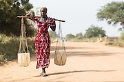 Mariam, 14, carries water from a UNICEF-sponsored pump back to her home in the village of Game, Guera province, Chad on Tuesday October 16, 2012.