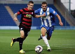 Peterborough United's Daniel Kearns in action with Colchester United's Ryan Dickson  - Photo mandatory by-line: Joe Dent/JMP - Tel: Mobile: 07966 386802 06/08/2013 - SPORT - FOOTBALL - Weston Homes Community Stadium - Colchester -  Colchester United V Peterborough United - Capital One Cup - First Round