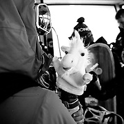 Lynsey Dyer plays with a unicorn hand puppet on the season opening tram ride.