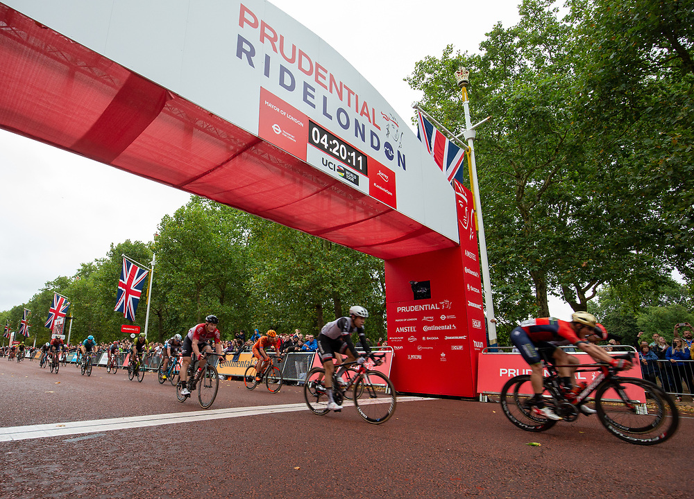 Riders cross the line at the end of The Prudential RideLondon Classic. Sunday 29th July 2018<br /> <br /> Photo: Andrew Baker for Prudential RideLondon<br /> <br /> Prudential RideLondon is the world's greatest festival of cycling, involving 100,000+ cyclists - from Olympic champions to a free family fun ride - riding in events over closed roads in London and Surrey over the weekend of 28th and 29th July 2018<br /> <br /> See www.PrudentialRideLondon.co.uk for more.<br /> <br /> For further information: media@londonmarathonevents.co.uk