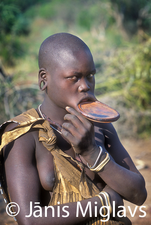 A Mursi tribe woman with lip plate in Omo Valley Ethiopia, Africa.