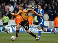 Photo: Ed Godden.<br />Wolverhampton Wanderers v Cardiff City. Coca Cola Championship. 11/03/2006. <br />Wolves' Gabor Gyepes (L) speeds away from Joe Ledley (R).