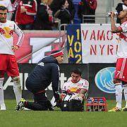 Tim Cahill, (centre), New York Red Bulls, injured as team mates Armando, (left), and Roy Miller, and the Red Bulls  trainer check on Cahill. Cahill left the match in the 27th minute during the New York Red Bulls V Chivas USA, Major League Soccer regular season match at Red Bull Arena, Harrison, New Jersey. USA. 30th March 2014. Photo Tim Clayton