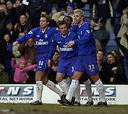 London, England, Barclaycard Premiership Football - Chelsea v Charlton, Eidur Gudjohnsen (No 17 Right) is congratulated by team mates, Graeme La Saux (Left) Jody Morris and Celestino Babayaro behind. Photo - Peter Spurrier.11/01/2003