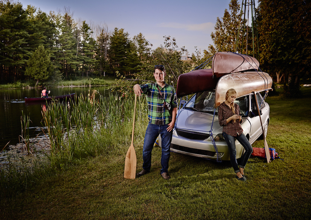 Two stereotypical Canadian College students after loading 3 canoes onto a small compact car ready for there vacation. Shot on a PhaseOne IQ180 as a Environmental Portrait.