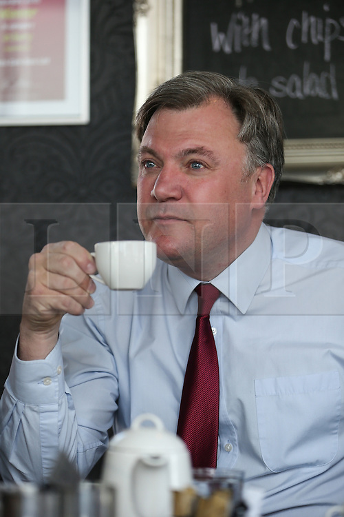 © Licensed to London News Pictures . 11/04/2015 . Bury , UK . ED BALLS . Labour Shadow Chancellor Ed Balls and James Frith , Labour candidate for Bury North , at a campaign stop at Barista coffee shop at The Rock , Bury in Greater Manchester , UK . The pair met parents and discussed family finances . Photo credit : Joel Goodman/LNP