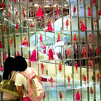 SHANGHAI, JUNE-14 :  Barbie dolls decorate a giant staircase inside the newly opened Barbie store.