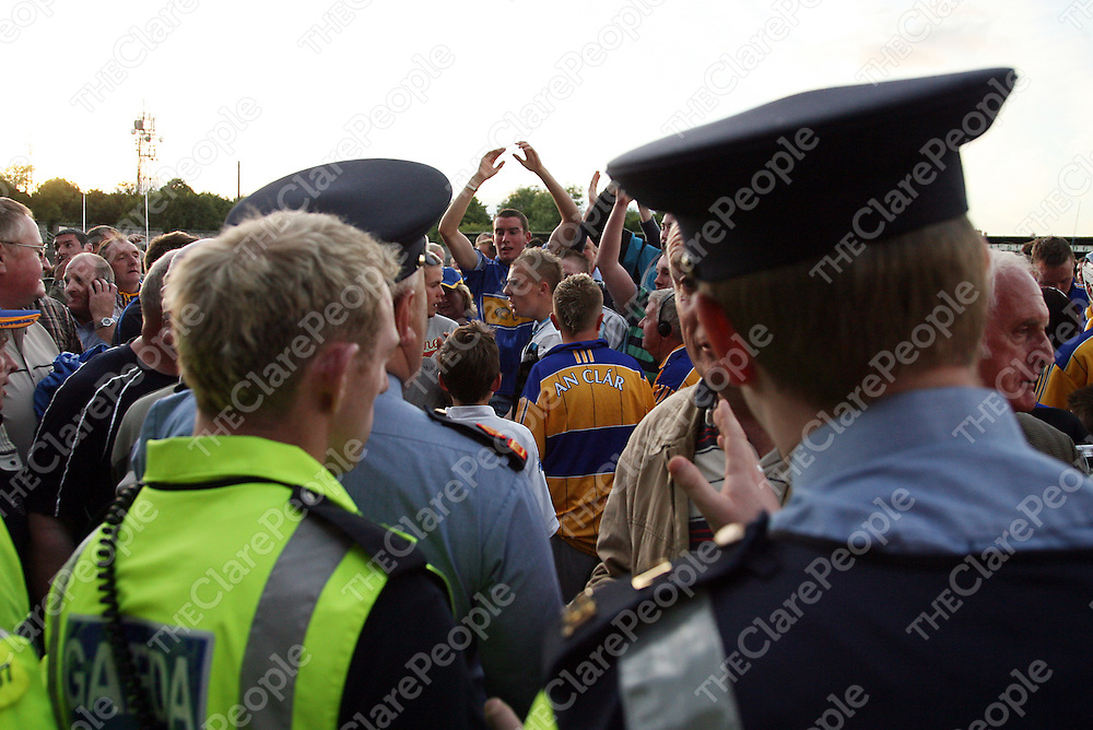 Gardai keep a watchful eye as Tipperary fans celebrate amongst Clare fans after the U-21 Munster final in Cusack Park on Wednesday evening.<br /> Photograph by Yvonne Vaughan