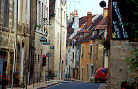 A street in Chablis, Burgundy with signs announcing places for tasting and sales of the famous local white wine