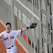 -Boston  MA, May 9, 2009-..Red Sox left fielder Jason Bay braces himself off the scoreboard while trying to track down a fly ball. ..(Photo by Michael Ivins/Boston Red Sox)