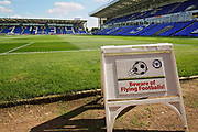 "A stadium shot including a ""beware of flying footballs sign"" before the EFL Sky Bet League 1 match between Peterborough United and Doncaster Rovers at London Road, Peterborough, England on 1 September 2018."