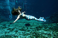 Mermaid Carli Dofka gently floats towards the bottom at Weeki Wachee Springs near Tampa, Florida.  The mermaid show is a living remant of Florida's past.