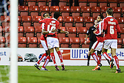 Swindon Town's Jonathan Obika is congratulated by his team mates after scoring the first goal during the Sky Bet League 1 match between Swindon Town and Walsall at the County Ground, Swindon, England on 24 November 2015. Photo by Shane Healey.