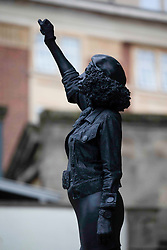 © Licensed to London News Pictures.15/07/2020. Bristol, UK. A statue of BLM protester Jen Reid, made by Mark Quinn is installed in Bristol on the empty plinth where the statue of 17th century slave trader and Bristol philanthropist Edward Colston used to stand. . Photo credit: Marcin Nowak/LNP