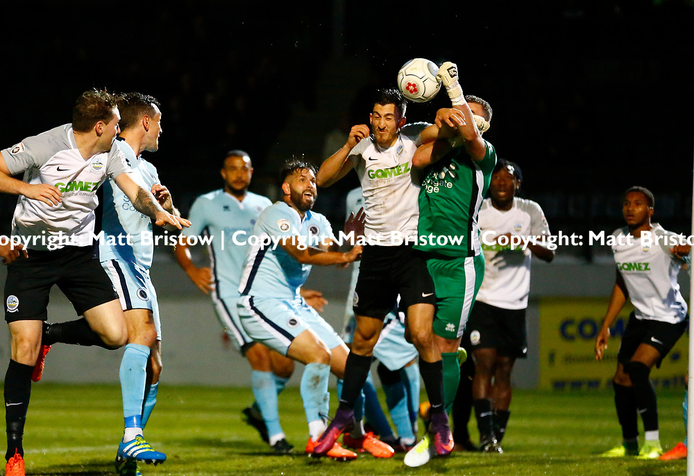 SEPTEMBER 12:  Top of the table Dover Athletic FChost eighth place Boreham Wood FC in Conference Premier at Crabble Stadium in Dover, England. The visitors, Boreham Wood  ran out winners a goal to nothing. Dover's defender Giancarlo Gallifuoco and Boreham Wood's goalkeeper Grant Smith locked contesting the ball. (Photo by Matt Bristow/mattbristow.net)