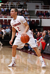 Nov 28, 2011; Stanford CA, USA;  Stanford Cardinal guard Aaron Bright (2) dribbles the ball up court against the Pacific Tigers during the first half at Maples Pavilion. Stanford defeated Pacific 79-37. Mandatory Credit: Jason O. Watson-US PRESSWIRE