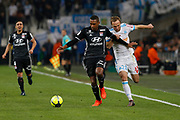 Valere Germain of Olympique de Marseille and Marcelos of Olympique Lyonnais during the French Championship Ligue 1 football match between Olympique de Marseille and Olympique Lyonnais on march 18, 2018 at Orange Velodrome stadium in Marseille, France - Photo Philippe Laurenson / ProSportsImages / DPPI