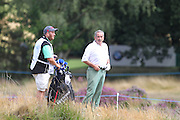 Sam Torrance in the rough on the 1st hole during The Senior Open Championship, Sunningdale Golf Club, Sunningdale, United Kingdom on 23 July 2015. Photo by Phil Duncan.