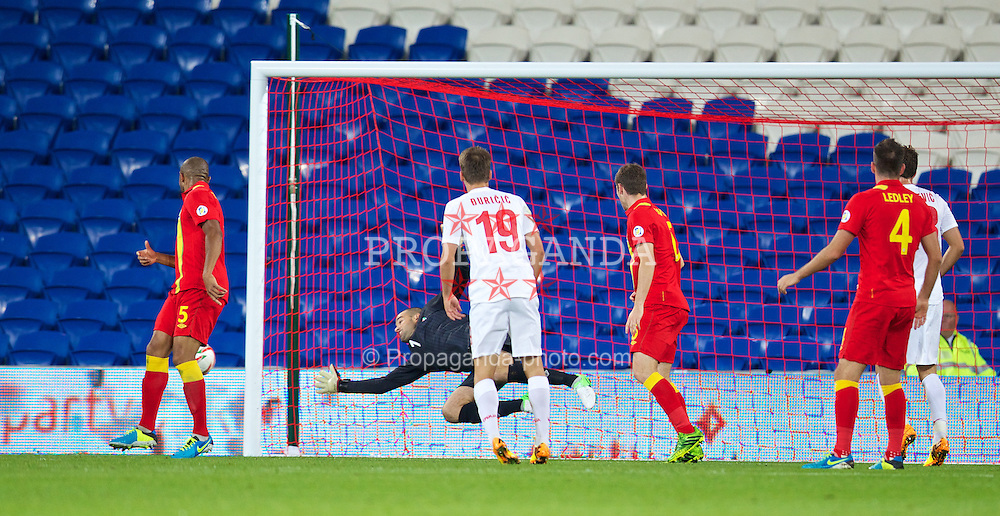 CARDIFF, WALES - Tuesday, September 10, 2013: Wales' goalkeeper Boaz Myhill is beaten for Serbia's third goal during the 2014 FIFA World Cup Brazil Qualifying Group A match at the Cardiff CIty Stadium. (Pic by David Rawcliffe/Propaganda)