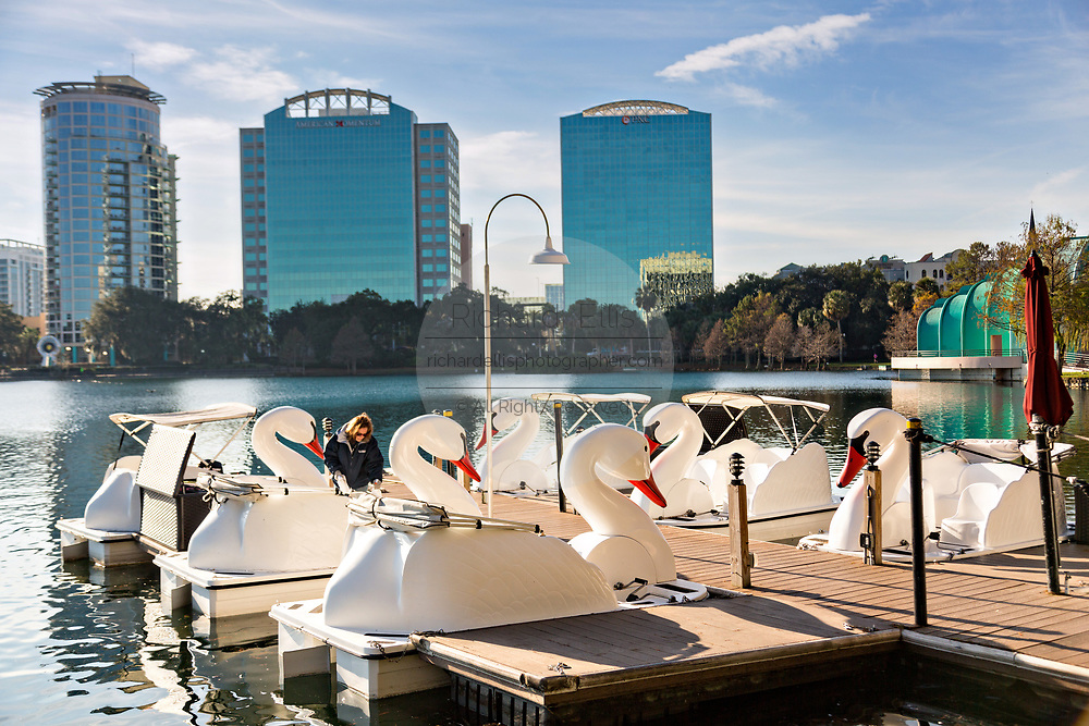 The famous swan boats and city skyline on Lake Eola Park in Orlando, Florida. Lake Eola Park is located in the heart of Downtown Orlando and home to the Walt Disney Amphitheater.