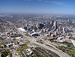 Aerial view of Houston, Texas featuring the downtown skyline and I-59 freeway.