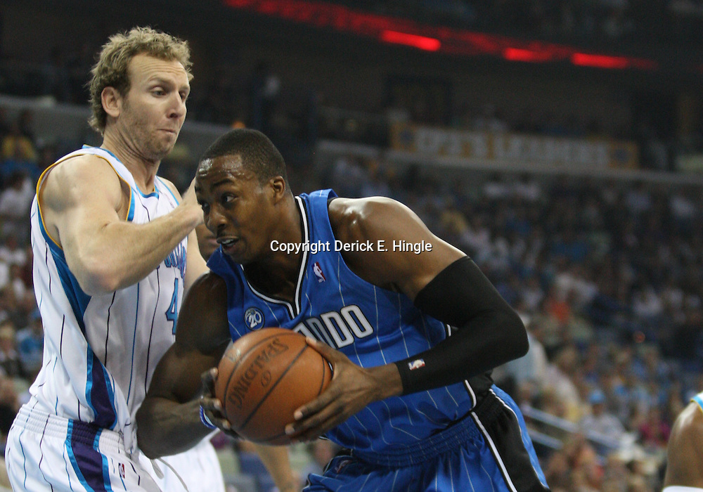 18 February 2009: Orlando Magic center Dwight Howard (12) is defended by New Orleans Hornets forward Sean Marks (4) during a NBA basketball game between the Orlando Magic and the New Orleans Hornets at the New Orleans Arena in New Orleans, Louisiana.
