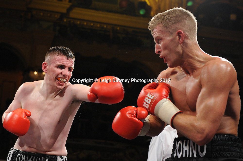 Chris Johnson (black shorts) defeats Peter McDonagh in a Welterweight contest at The Winter Gardens, Blackpool on the 31st March 2012. Frank Maloney and Steve Wood VIP Promotions. © Leigh Dawney Photography 2012.