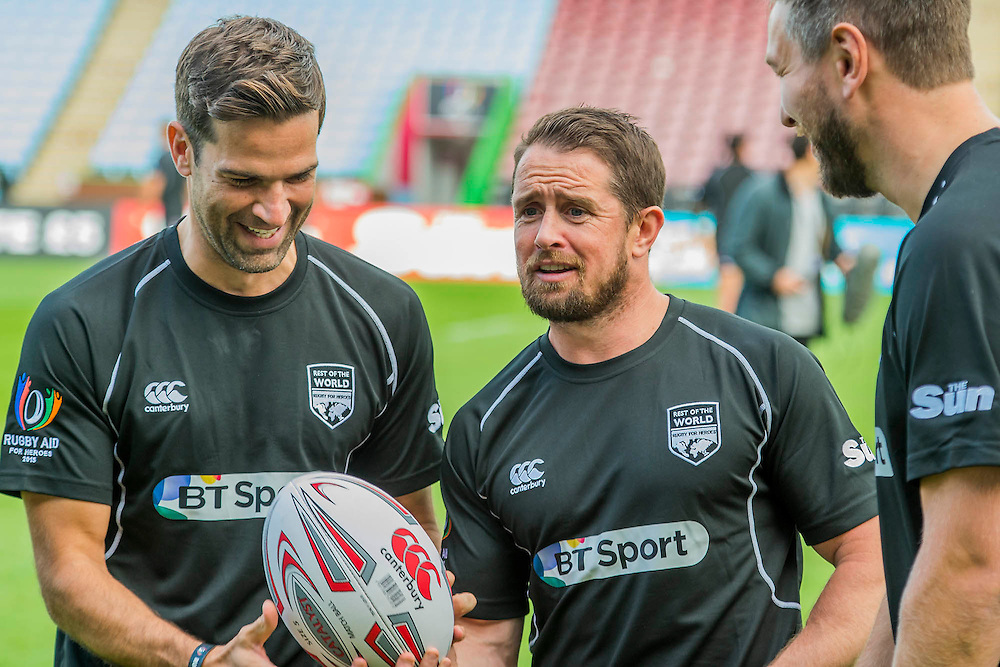 Shane Williams shares a joke with Gethin Jones - Training starts for inaugural RUGBY AID 2015 charity match which takes place on Friday 4th September 2015 at the Twickenham Stoop. The celebrity charity game will be in aid of RUGBY FOR HEROES  of which Mike Tindall MBE is Patron. The charity raises funds and awareness through the sport of rugby, the fan community and the wider professional player network, to support military personnel who are making the transition back from military service to civilian life. The teams (England v's Rest of the World) include former international rugby players, celebrities and serving members of the armed forces. Harlequins Rugby , The Stoop, Twickenham, London UK, 02 Sept 2015