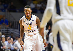 Nov 16, 2015; Charleston, WV, USA; West Virginia Mountaineers guard Daxter Miles Jr. celebrates after scoring during the first half against the James Madison Dukes at the Charleston Civic Center. Mandatory Credit: Ben Queen-USA TODAY Sports