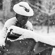 J Seward Johnson Jr's The Newspaper Reader capture during a snow storm on December 9, 2017