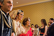 Baltimore, Maryland - December 20, 2014: Trisha Satya Pasricha is flanked by her parents Pankaj, left, and Reena, right, as they escort her to the mandap, a traditional Hindu structure where the wedding takes place, in one of the Baltimore Marriott Waterfront Hotel's ballrooms. <br /> <br /> Trisha Satya Pasricha and Eshwan Ramudu married at the Baltimore Marriott Waterfront Hotel December 20, 2014. <br /> <br /> <br /> CREDIT: Matt Roth for The New York Times<br /> Assignment ID: 30168620A