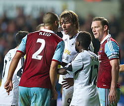 27.10.2013, Liberty Stadion, Swansea, ENG, Premier League, Swansea City vs West Ham United, 09. Runde, im Bild Swansea City's Miguel Perez Cuesta 'Michu' is accused using an elbow by West Ham United's Winston Reid // during the English Premier League 09th round match between Swansea City AFC and West Ham United at the Liberty Stadion in Swansea, Great Britain on 2013/10/27. EXPA Pictures © 2013, PhotoCredit: EXPA/ Propagandaphoto/ David Rawcliffe<br /> <br /> *****ATTENTION - OUT of ENG, GBR*****