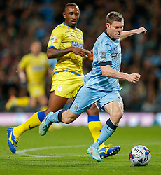 James Milner of Manchester City is challenged by Kamil Zayatte of Sheffield Wednesday - Photo mandatory by-line: Rogan Thomson/JMP - 07966 386802 - 24/08/2014 - SPORT - FOOTBALL - Manchester, England - Etihad Stadium - Manchester City v Sheffield Wednesday - Capital One Cup, Third Round.
