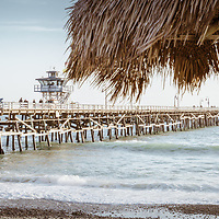 San Clemente pier and tiki umbrella retro panorama photo. San Clemente is a popular beach city in Orange County Southern California in the States of America. Panorama photo ratio is 1:3. Copyright ⓒ 2017 Paul Velgos with all rights reserved.
