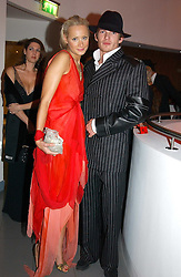 KALITA AL-SWAIDI and JACOBI ANSTRUTHER-GOUGH-CALTHORPE at Andy & Patti Wong's Chinese New Year party to celebrate the year of the Rooster held at the Great Eastern Hotel, Liverpool Street, London on 29th January 2005.  Guests were invited to dress in 1920's Shanghai fashion.<br />