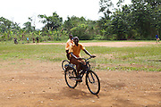 School grils ride some of the bicycles that have been provided by Cadburys at the Mbaem community school, Ghana.