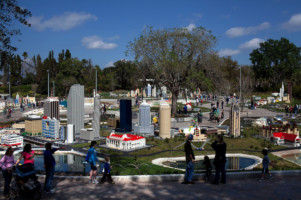 People walk through Miniland in Legoland in Whitehaven, Florida on February 11, 2012.