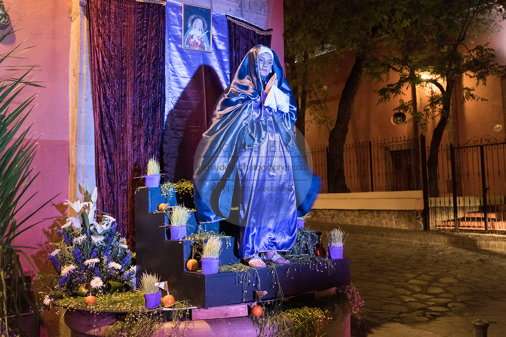 A young girl dressed as the Virgin Mary poses during a live altar for El Viernes de Dolores during Holy Week outside the Angela Peralta Theater March 23, 2018 in San Miguel de Allende, Mexico. The event honors the sorrow of the Virgin Mary for the death of her son and is an annual tradition in central Mexico.