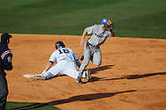 Memphis shortstop Chad Zurcher tags out Ole Miss' Matt Smith (16) at Oxford University Stadium in Oxford, Miss. on Tuesday, February 22, 2011.