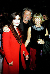 Left to right, MISS SHEBAH RONAY with her parents MR DICK POLAK and EDINA RONAY the fashion designer,  at a party in London on 8th March 2000.OBY 21